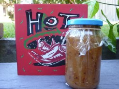 Jar of apple chutney with book that includes the recipe
