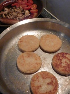 Welsh Potato Cakes being fried in the pan.