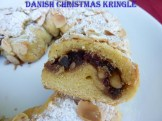 Danisk Christmas Kringle with cranberry folling dusted with icing sugar and flaked almonds