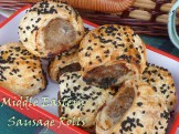 small sausage rolls topped with nigella seeds