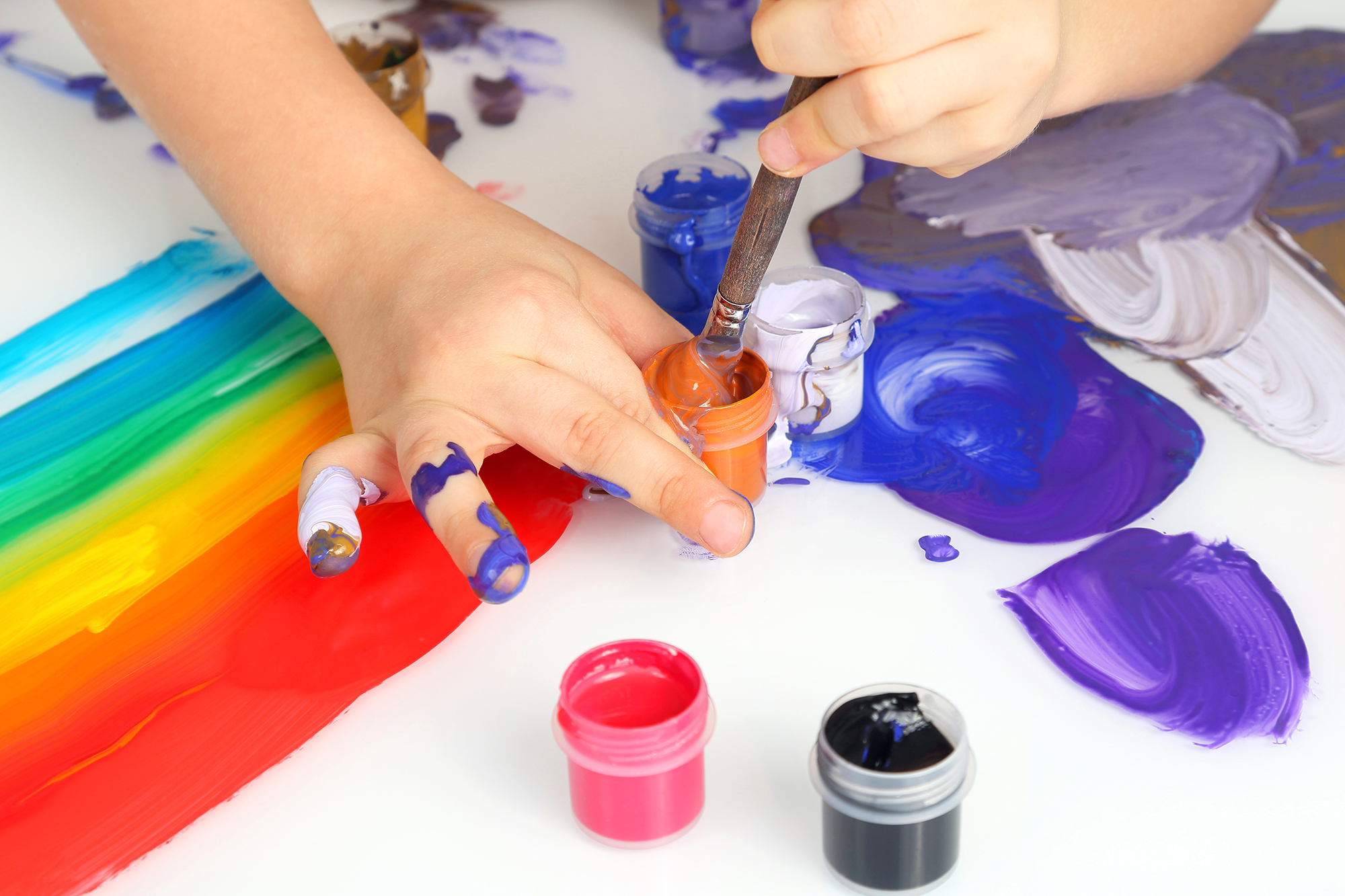 The stages of art development evolves as a child is given creative freedom to explore and experiment with various forms of tools and colors.