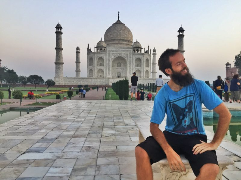 person with taj mahal in the background