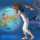 Young girl dreaming of touching giant globe of the world