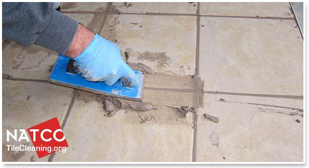 how to apply grout in a tile floor