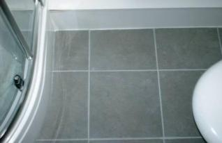 Grout Colour restored on a Ceramic Tiled Bathroom Floor by the Tile Doctor - After Picture