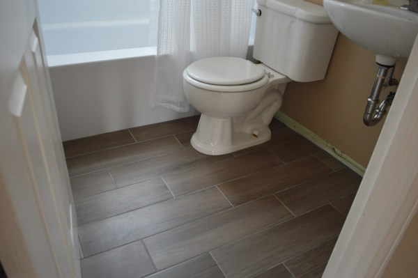 White Bathroom Floor Tile with Wood