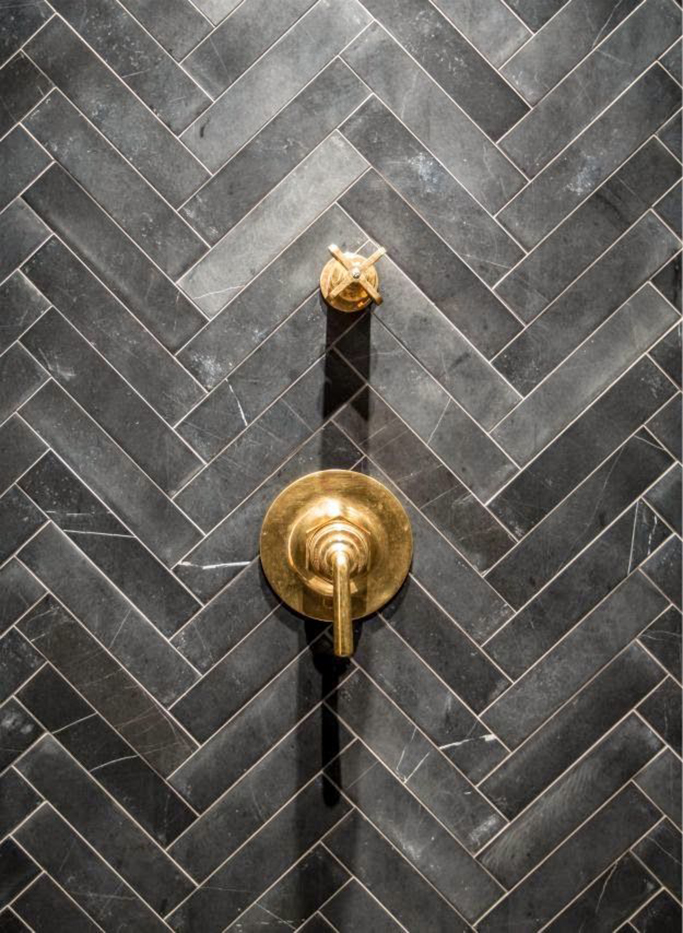 Black metro tiles in herringbone pattern