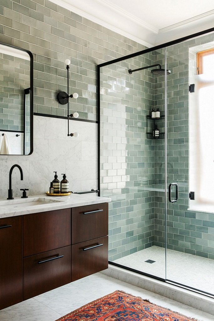 4d9e78739f64 Take inspiration from the bathroom above by Elizabeth Roberts and frame a  sage green metro tile with black accents. This stunning walk in shower ...