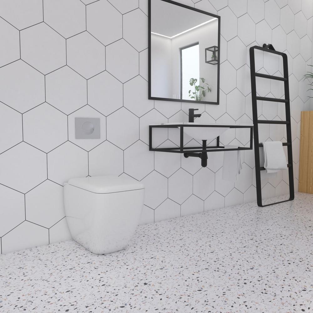 Apollo Hexagon White Wall Tiles & Ofelia Floor Tiles from Tile Mountain / Iker Black Matte Towel ladder, Square Mirror, and matte Black Steel Frame from Soak