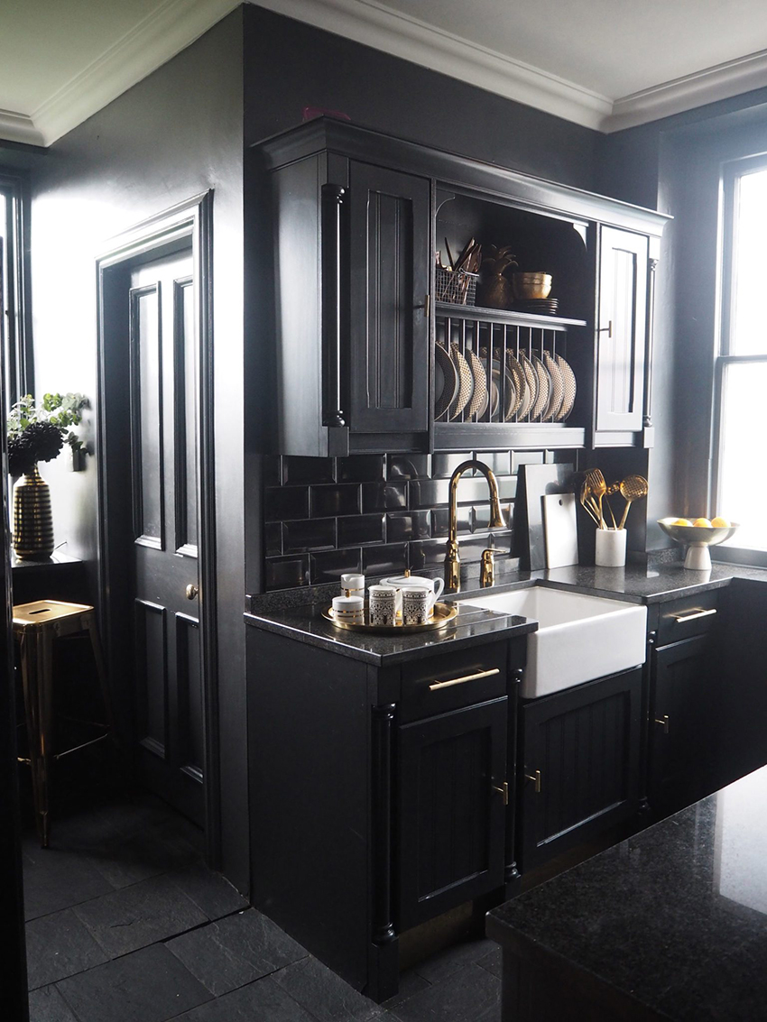 Black kitchen with gold hardware