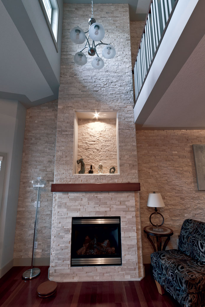 Ivory Splitface and Ivory Cubic Ledgestone installed on a fireplace and feature wall