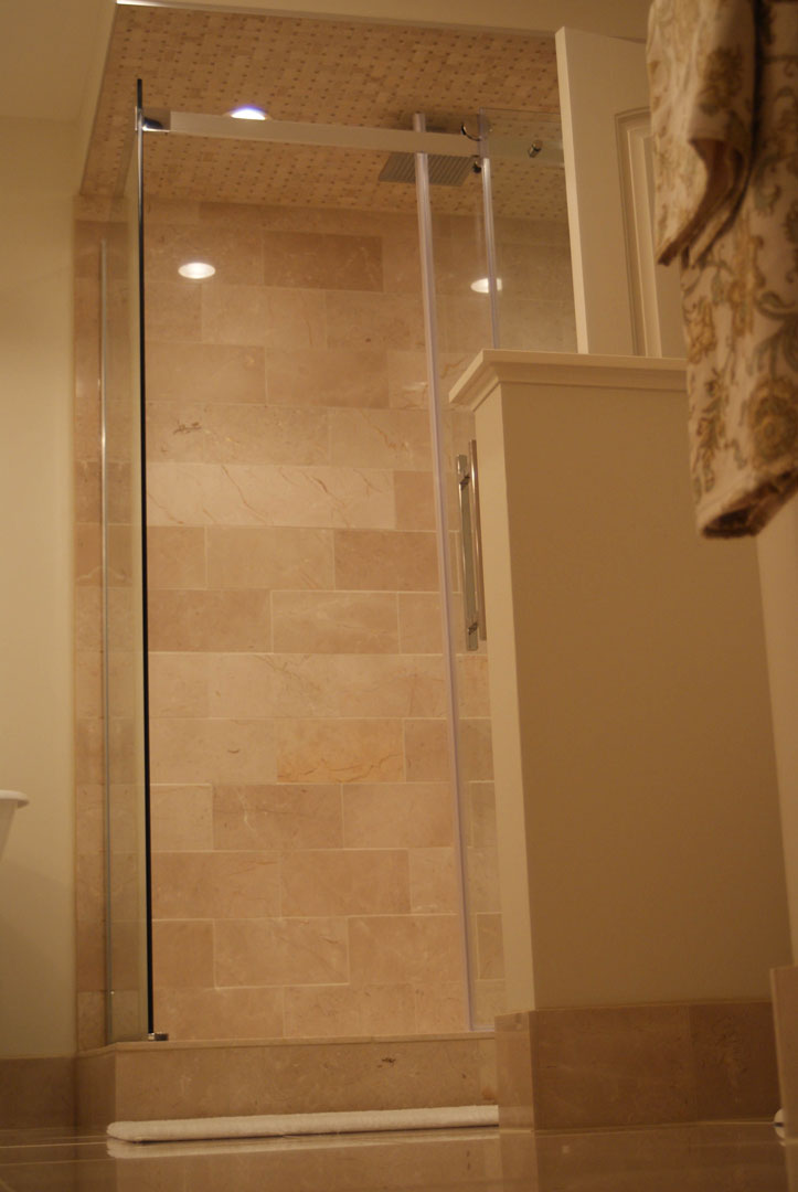Royal Crema marble tile and Royal Crema marble mosaic installed in a shower