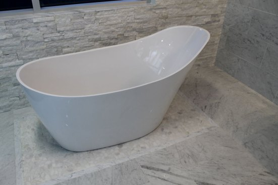Freestanding Fleurco Tub with marble surround