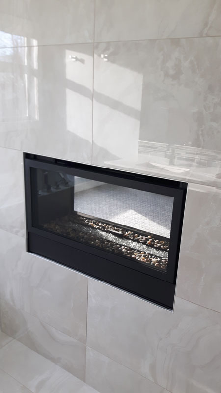 Cloud Grey Porcelain installed on a fireplace