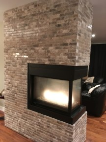 Cosme 2x6 Polished splitface installed on a 3-sided fireplace