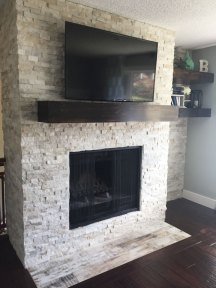 Muskoka Saddle Porcelain and Fantasia Slate Splitface installed on a fireplace