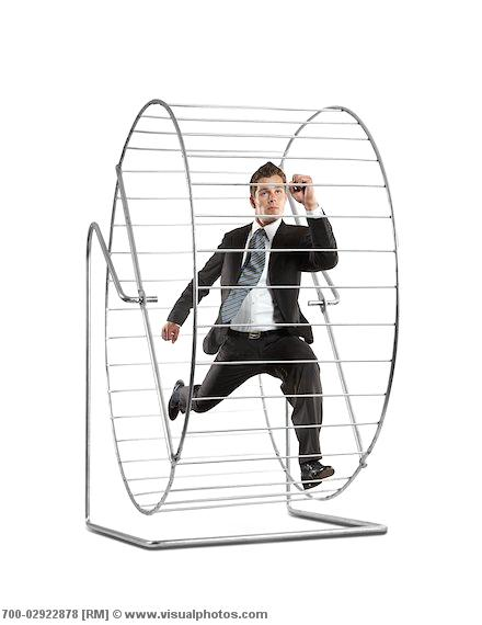 Businessman Running on a Hamster Wheel