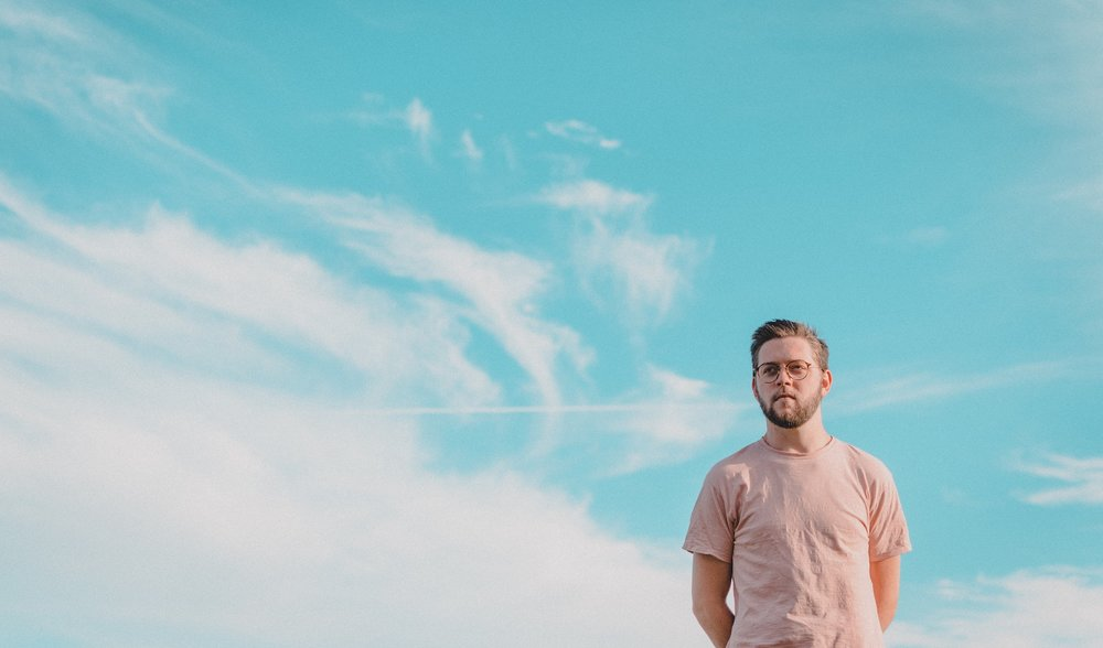 man with sky in background