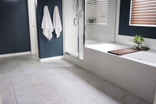 How to prep and tile your bathroom floors using either small scale mosaic sheets or large scale 12x24 tiles!