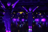 """TCHS Sky Dancers perform a glowing dance routine during the """"Blackout"""" blacklight pep rally, Nov. 7, 2014. (Photo by The Creek Yearbook photographer Sabrina Trejo.)"""