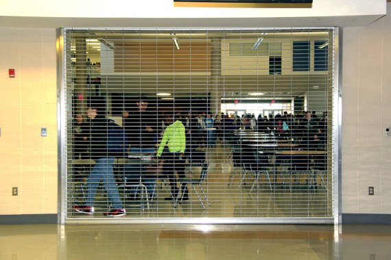 Students are seen in the cafeteria through the security gates that limit access to the cafe portion. (Photo by The Creek Yearbook photographer Nancy Davis.)