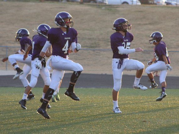 Freshman football players warm up before a game. (Photo by The Creek Yearbook photographer AJ Fletcher.)