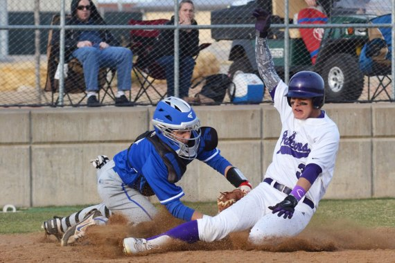 A Timber Creek player slides into home. (Photo by The Creek Yearbook photographer Kaitlyn Cass.)