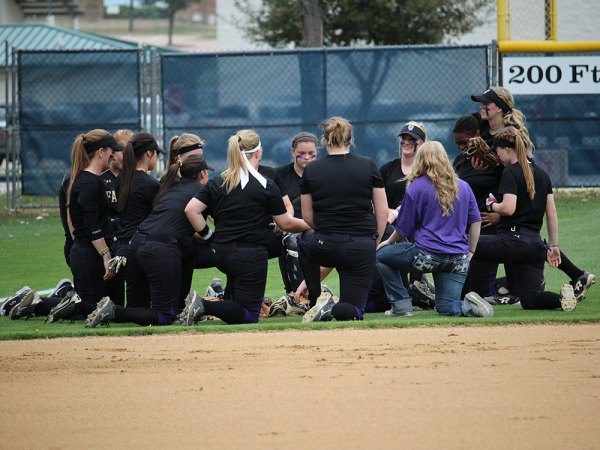 Timber Creek varsity softball players take a knee before a Feb. 7, 2015 game against Keller. (Photo by The Creek Yearbook photographer Lindsay Garner.)
