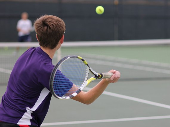 A TCHS JV tennis player practices on Sept. 18, 2014. (Photo by The Creek Yearbook photographer Austin Pickell.)