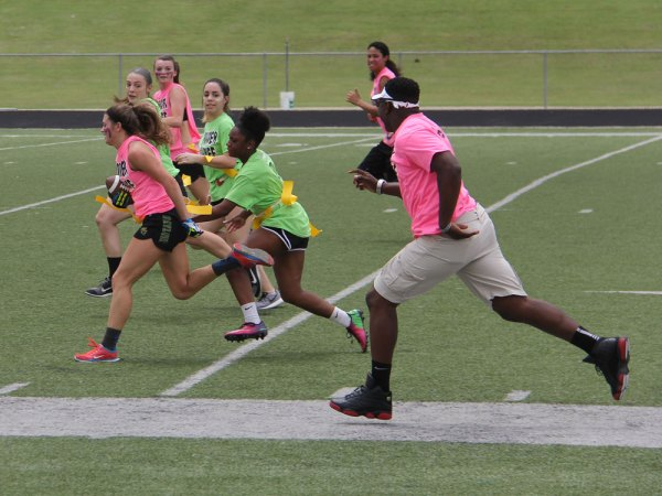 Seniors run the ball during the 2015 Powder Puff football game. (Photo by Talon photographer Hannah Dykes)