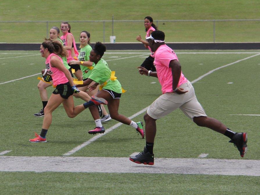 Seniors run the ball during the 2015 Powder Puff football game. (Photo by Talon photographer Hannah Dykes)