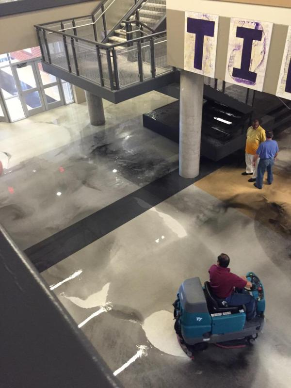 Photo from Talon reporter Gracy Whitaker showing custodial staff cleaning up the broken pipe on June 1, 2015.