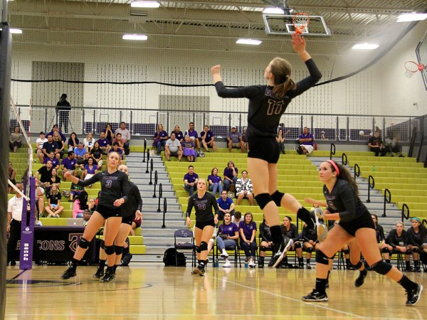 A Timber Creek Varsity Volleyball player leaps for the ball during the Sept. 1, 2015 home game against Weatherford. (Photo by Talon reporter Hannah Dykes.)