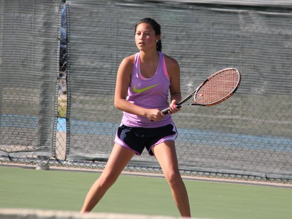 Tennis player Stacy Wan practices on the Timber Creek court. (Photo by The Creek Yearbook photographer Tavin Stewart.)