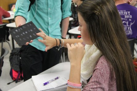Students and teachers participate in the Pinky Promise for Peace art project on Nov. 18, 2015. (Photos by The Creek Yearbook photographer Milly Orellana)