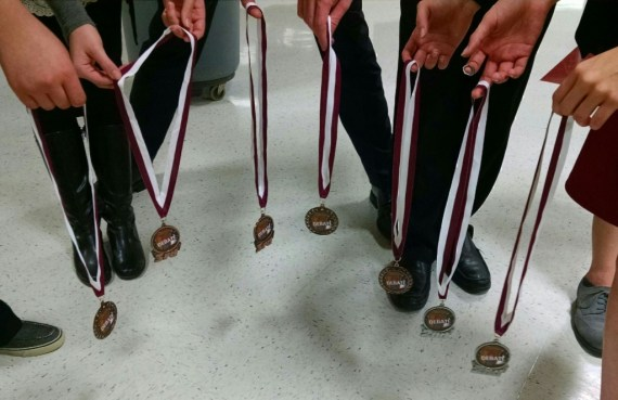 Speech and Debate team members hold their medals earned at the Wylie tournament in November 2015.