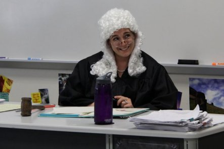 AP World History teacher Melissa Taylor acts as judge during a mock trial for Genghis Khan in her WHAP class.