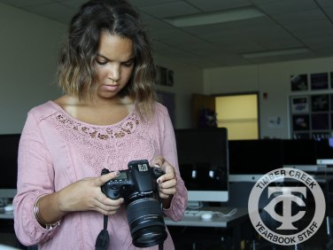 Yearbook editor Kelsey Crawford reviews photos on a camera. (Photo by Lindsay Garner)