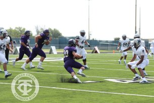 Turf flies behind a Timber Creek player during the Sept. 2, 2017 home opener. (Photo by Yearbook Editor Taylor Deker.)