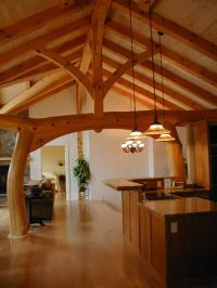 Timber Frame House with a Taiko Beam built in Memramcook ...