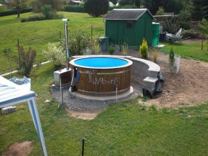 Plastic vintage hot tub with outdoor oven