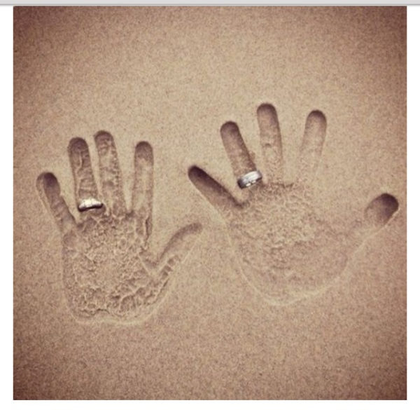 Honeymoon Memories to Save - Hands in Sand