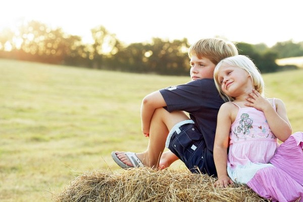 Memorable Birthday Party - Children sitting on Haystack