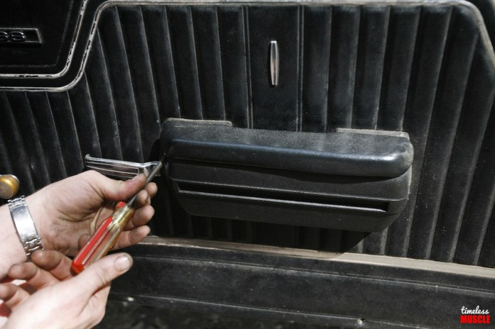 Removing the door panels couldn't be simpler; simply remove the screws holding the arm rest/door handle in place...