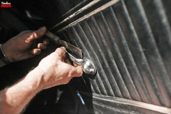Next, you need to pop the window crank off with either a scraper like we have here, or a specialized tool just for the task. In the case of our Chevelle, the window cranks basically slid right off. Each car is a little different, so if you do a window crank removal tool, we recommend that you use it!