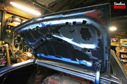 It was the same story when you look underneath the trunk lid as well. The old paint just peels off in clumps, and we'll be very happy when we get this thing blasted, primed and painted back to its factory hue!