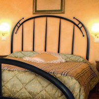 Pictured here is the Pinnacle Wrought Iron Headboard hand ...