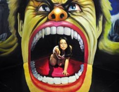 asian woman with hulk painting