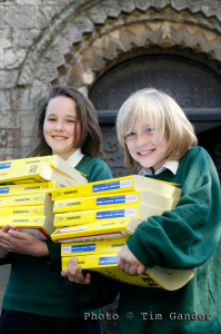 children carrying yellow pages