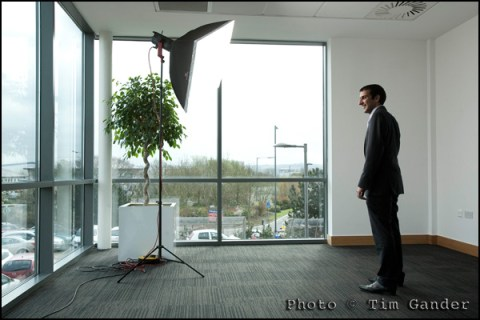 man in suit being photographed in office